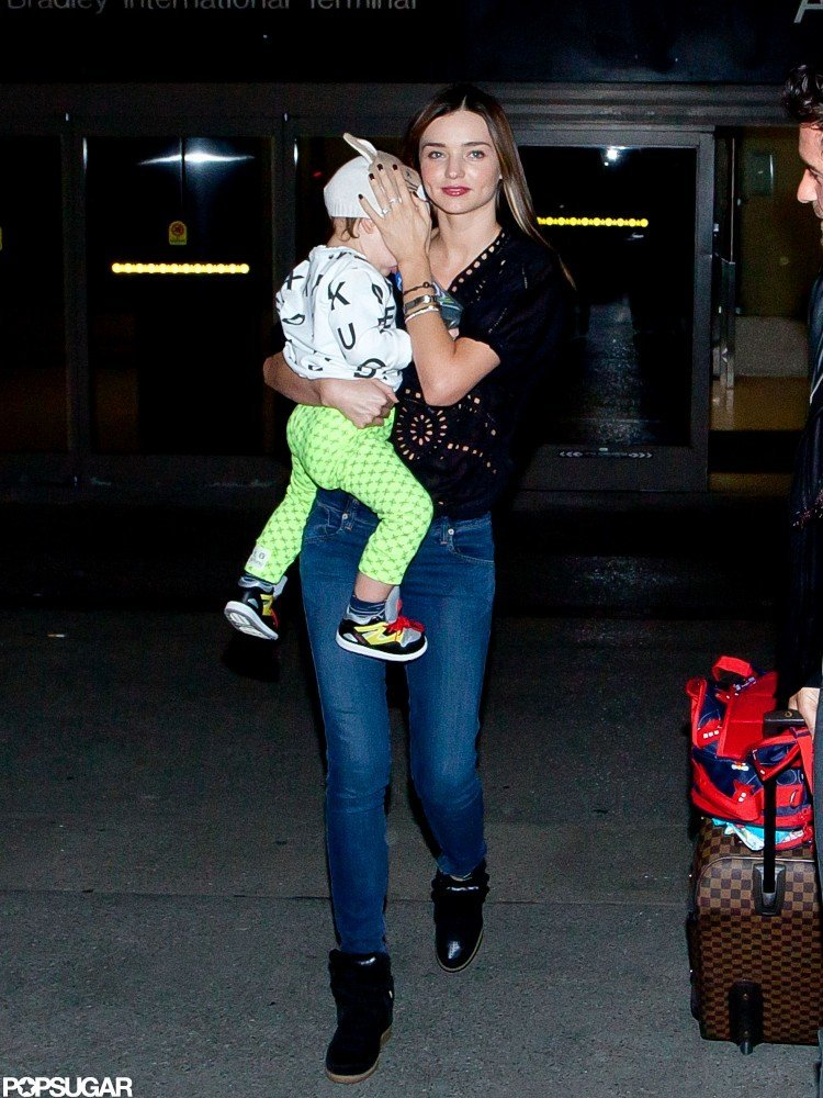 Miranda Kerr carried Flynn Bloom through LAX.