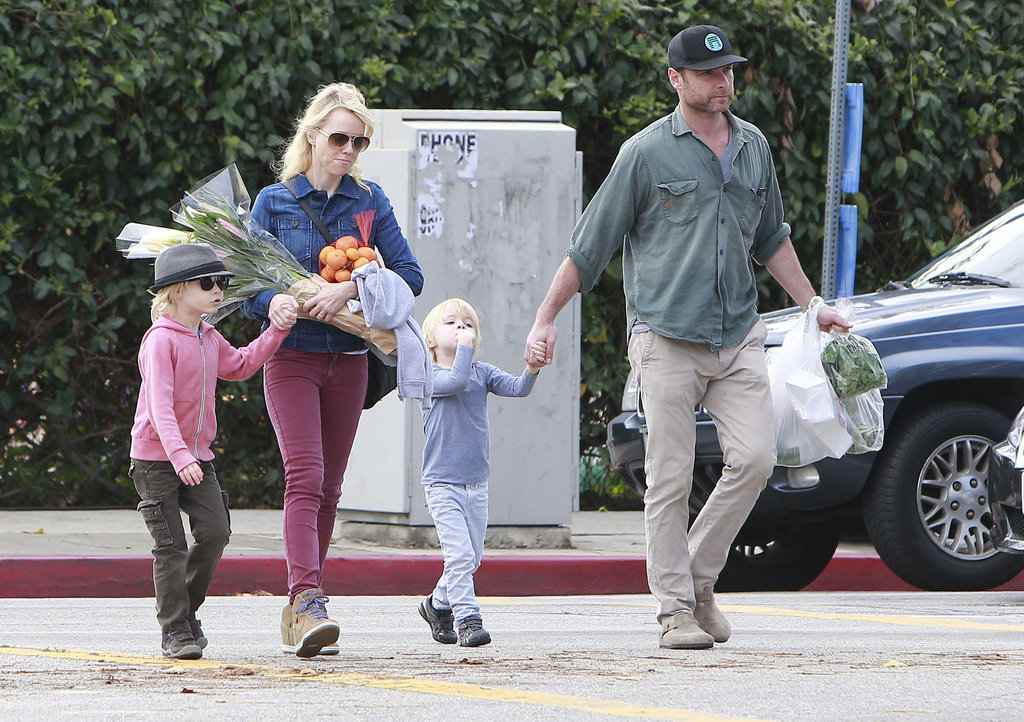 Naomi Watts and her family held hands as they crossed the street Sunday in Brentwood.
