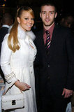 Justin Timberlake posed with Mariah Carey at the Rock and Roll Hall of Fame ceremony in March 2005.