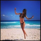 Miranda Kerr jumped on the beach in Mexico. Source: Instagram user mirandakerrverified
