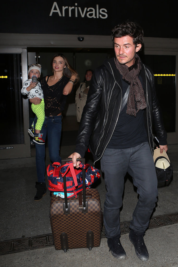 Miranda Kerr carried Flynn Bloom through LAX as Orlando Bloom took care of their bags.