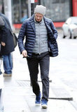 David Beckham wore a hat and two coats for a London stroll.
