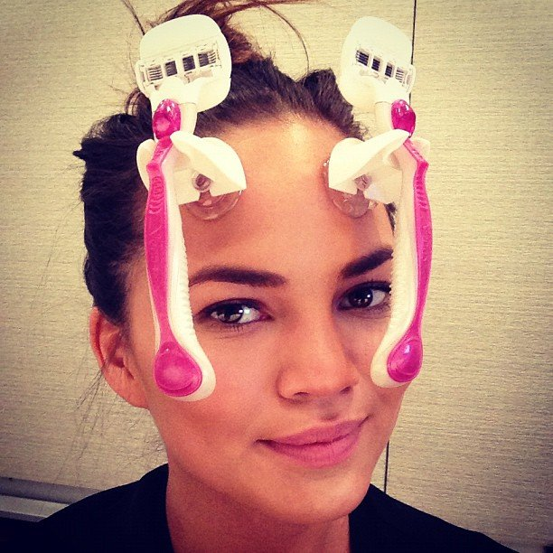 Chrissy Teigen goofed off during a meeting. Source: Instagram user chrissy_teigen