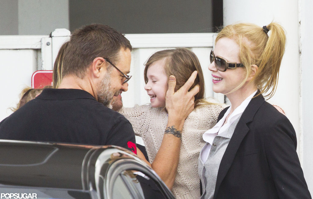 Russell Crowe arrived at an airport in Australia to pick up Nicole Kidman and her kids.