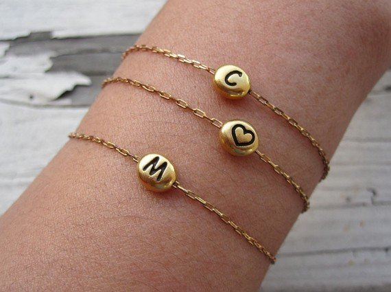 We love the idea of giving these Charlie and Marcelle gold initial bracelets ($25) individually, or as a set for a cool layered look.