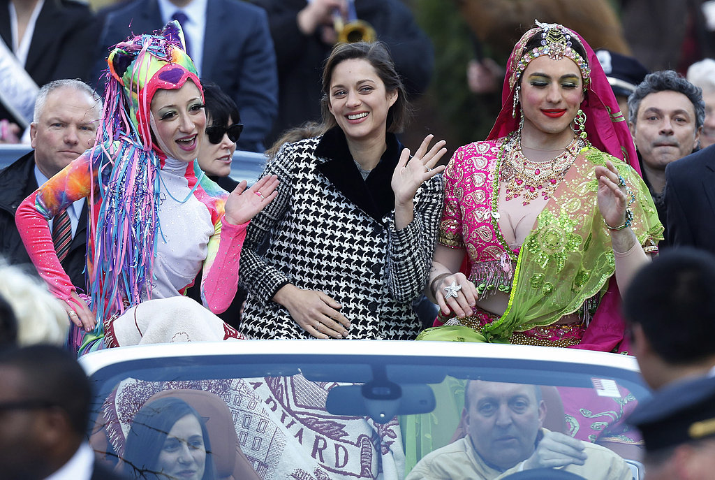 Marion Cotillard rode in the back of a convertible as she waved for fans.