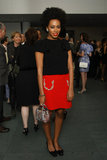 Solange Knowles paired a classic black top with a punchy red skirt, then completed her ensemble with black bow flats and a sequined mini bag. To get her look, wear a basic black tee with a red miniskirt and an equally snazzy bag.