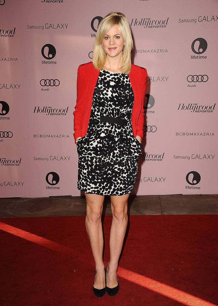 The New Normal actress Georgia King topped her black-and-white printed dress with a bold red jacket. Add a red topper to any of your dresses to nail this look.
