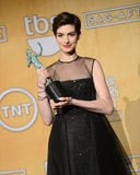 Anne Hathaway held up her award — for best supporting actress — in the media room at the SAG Awards on January 28.