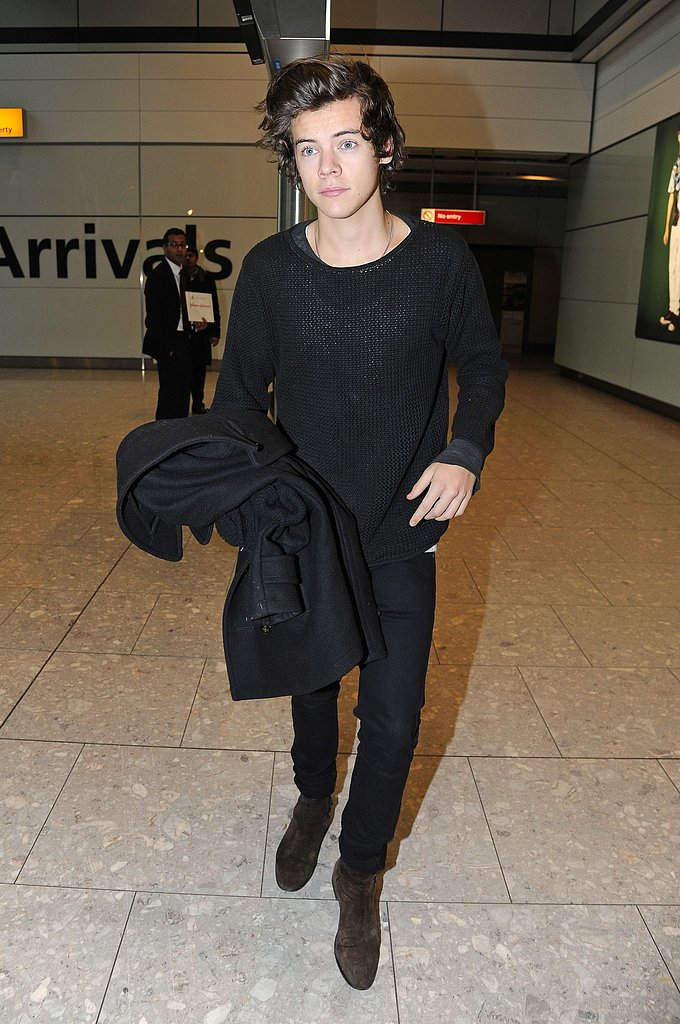 An all-black-clad Harry Styles faced the waiting media as he walked through Heathrow airport in London on January 28.