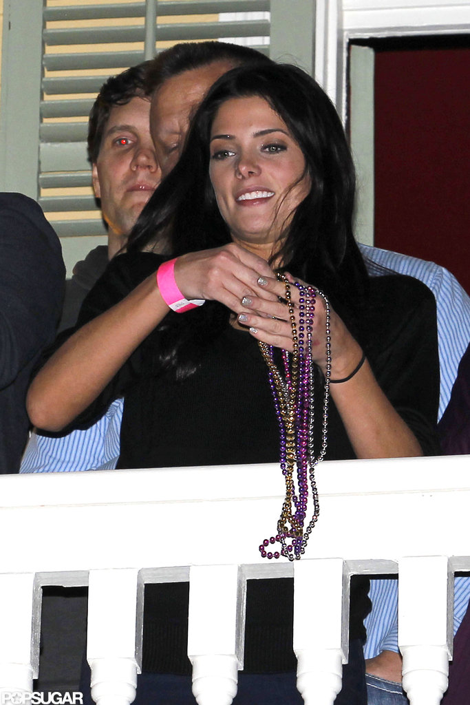 Ashley Greene threw Mardi Gras beads off a bar balcony Friday night during the 2013 Super Bowl weekend in New Orleans.