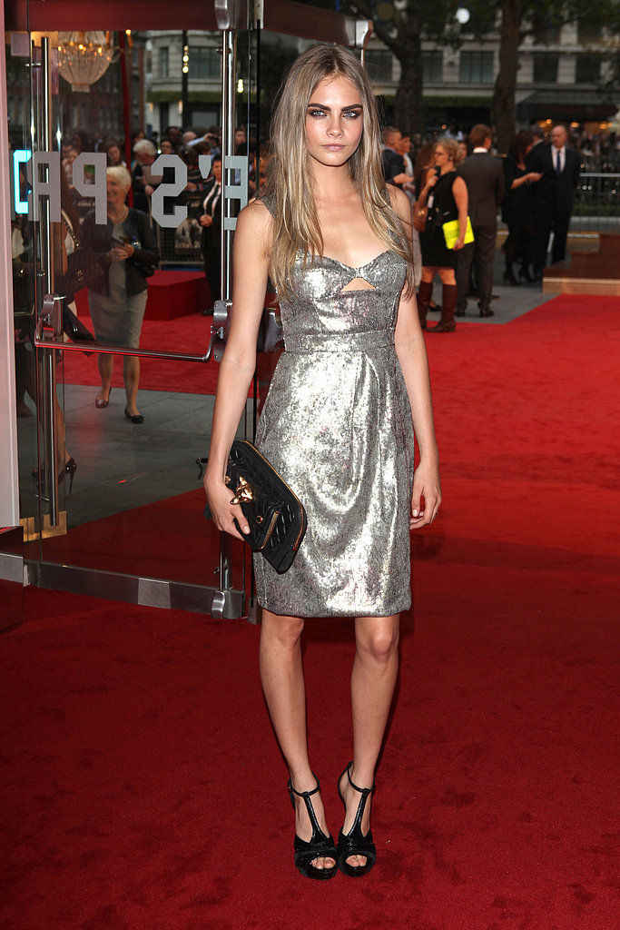 Cara Delevingne (yet again) showcased her love of Burberry by rocking a silver sequin cut-out confection with black velvet t-strap sandals and a fox quilted clutch, all by the design house, at the world premiere of Anna Karenina in London.