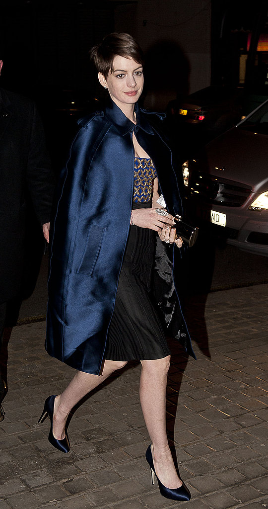 Anne Hathaway went dramatic in an Altuzarra dress with a brocade bodice and black skirt topped with a sapphire silk Burberry cape and matching pumps at a Les Misérables after-party in London. Sparkling jewels and a mirrored clutch finished off her party style.