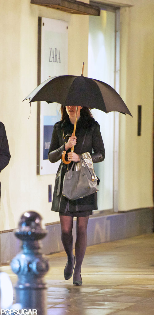 Kate Middleton used her umbrella while shopping in London.  Source: Simpson/Bushell
