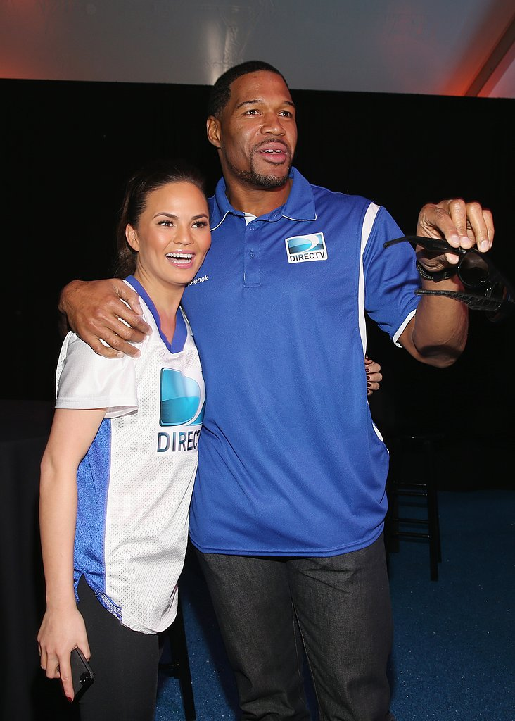 Chrissy Teigen hung out with Michael Strahan at the celebrity beach bowl in New Orleans.