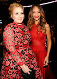 Rihanna and Adele co-ordinated in bright red.