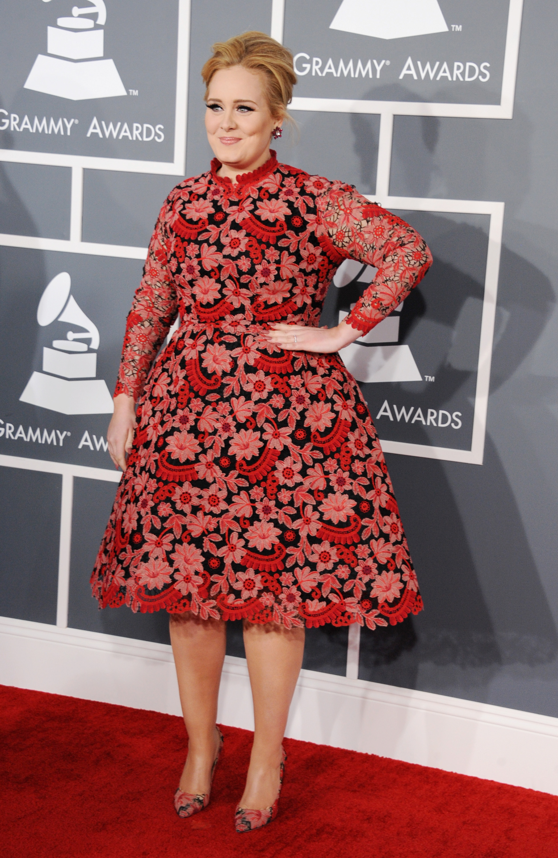 Adele posed on the Grammys red carpet in a Valentino dress.