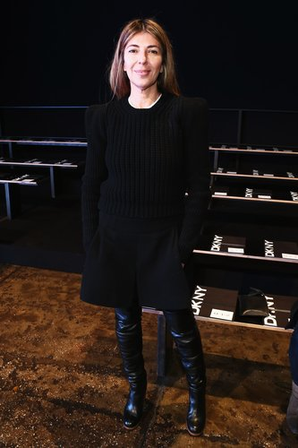 Nina Garcia looked appropriately fashion-forward in all black at DKNY.