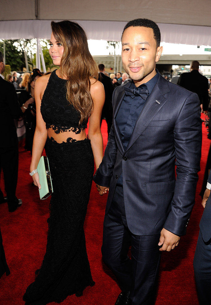 Chrissy Teigen and John Legend held hands on the carpet.