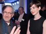 Anne Hathaway and Steven Spielberg chatted with guests at the Oscars luncheon Monday in Beverly Hills.