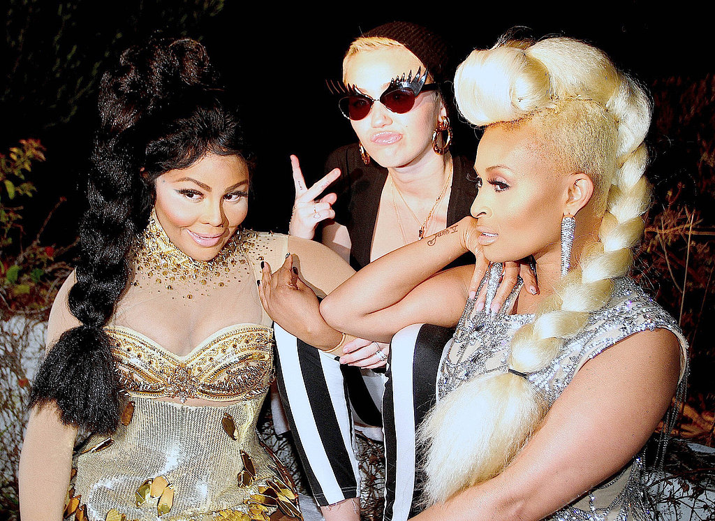 Miley Cyrus linked up with Lil' Kim and Tiffany Foxx to shoot a music video in LA.