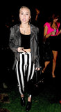 Miley Cyrus wore striped pants and a crop top in LA.