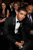 Drake looked dapper in his suit while sitting front row in 2012.