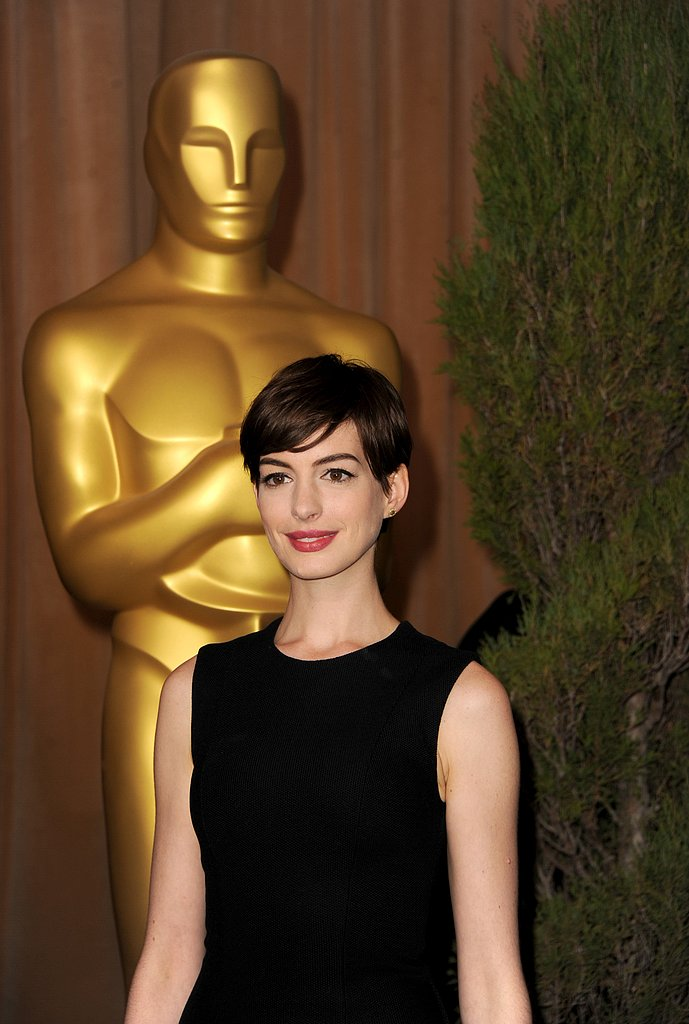 Anne Hathaway smiled on the red carpet at the 2013 Oscars luncheon in Beverly Hills.