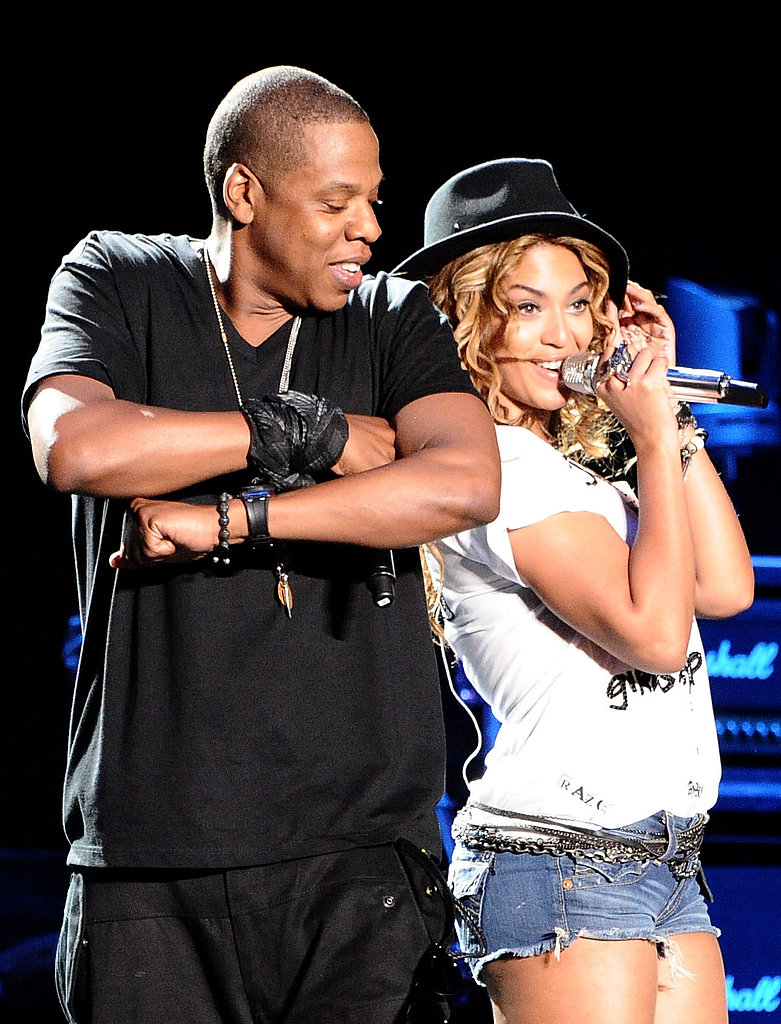 Beyoncé and Jay Z shared back-to-back smiles while performing together at Coachella Valley Music and Arts Festival in April 2010.