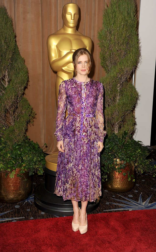 Amy Adams attended the Oscars luncheon in a long floral ensemble on Monday.