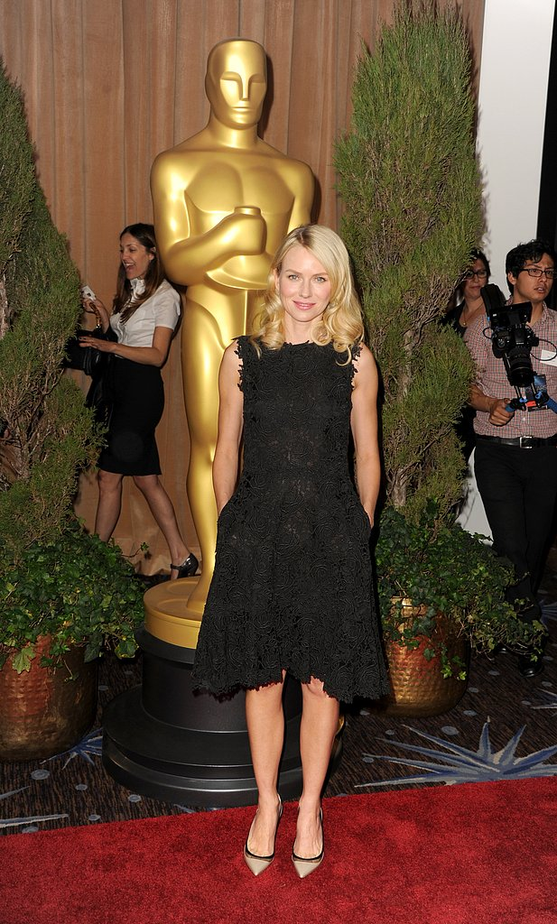 Naomi Watts selected a feminine black embroidered fit-and-flare sheath and perfected the luncheon ensemble with a pair of ladylike black-trimmed pointed-toe pumps.