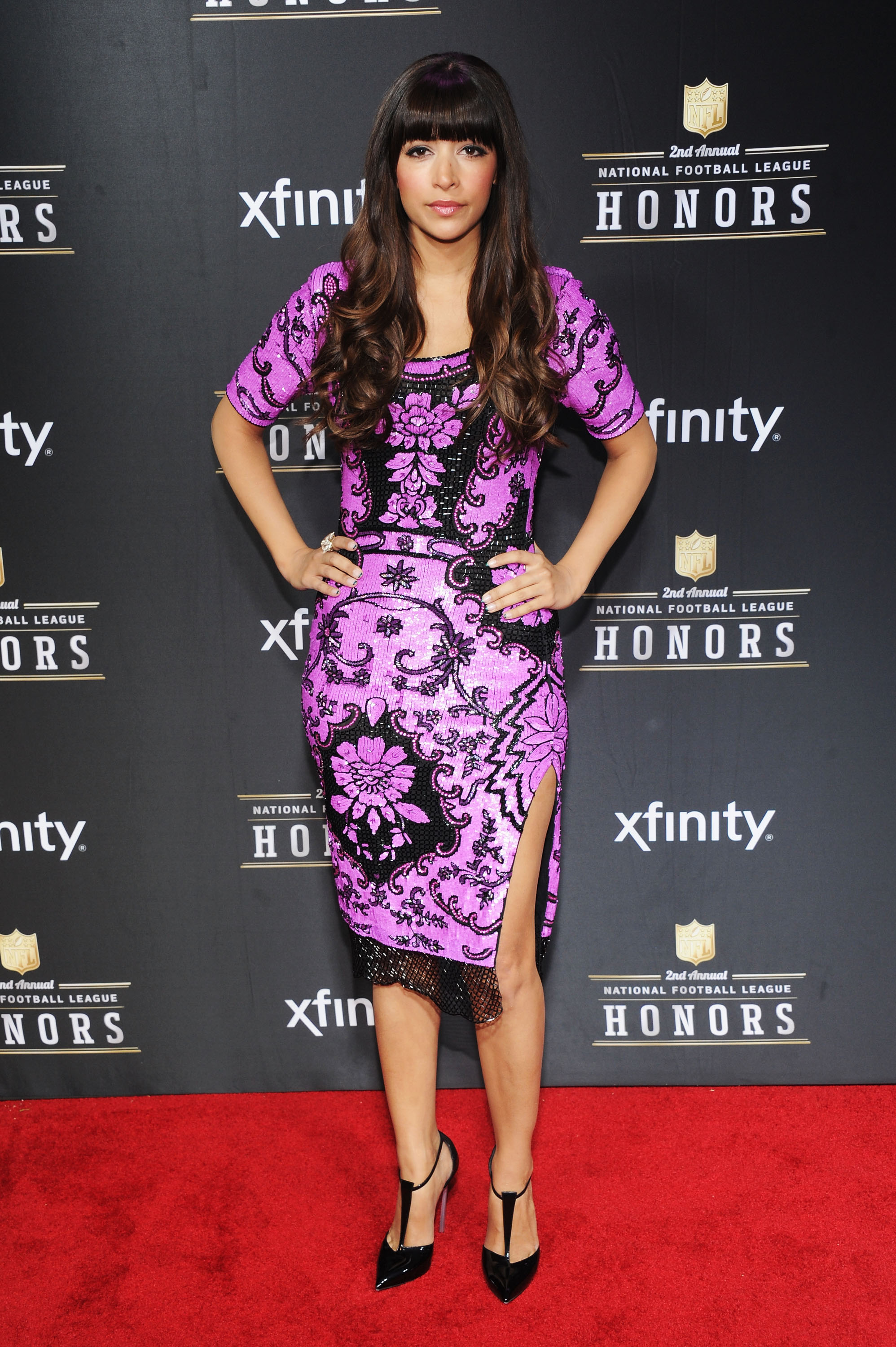 Hannah Simone didn't short on the bold prints, bright purple color, or thigh-high split appeal at the NFL Honors award show.