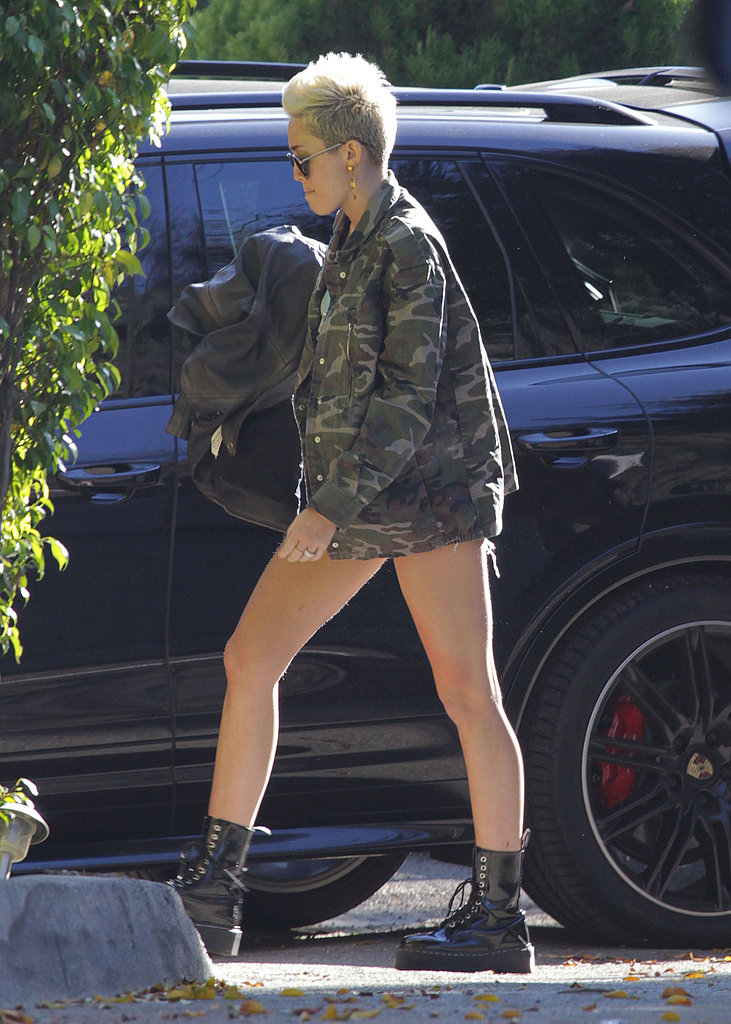 Miley Cyrus Shows Skin in the Sun but Feels Under the Weather