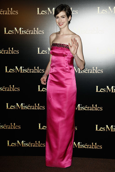 Anne Hathaway wore a pink Prada gown at the Paris premiere of Les Mis.