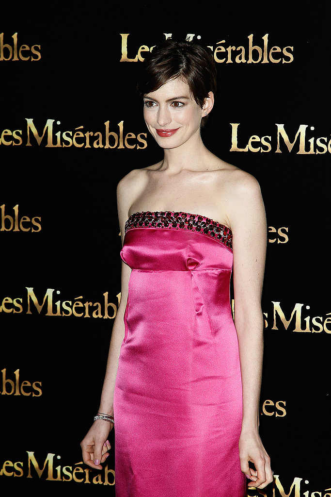Anne Hathaway Brings a Pop of Pink to Her Paris Premiere