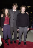 Mila Kunis and Ashton Kutcher posed with their That '70s Show costar Danny Masterson at the December 2000 premiere of Traffic in LA.