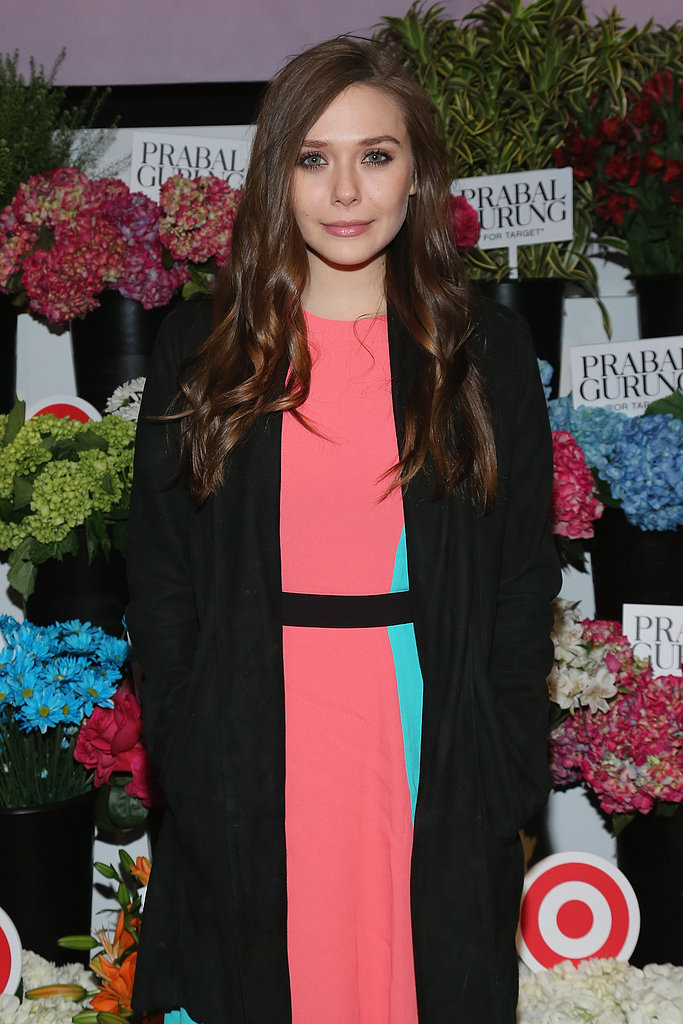 Elizabeth Olsen sported a black coat over a colorblocked dress at the Prabal Gurung for Target launch party.