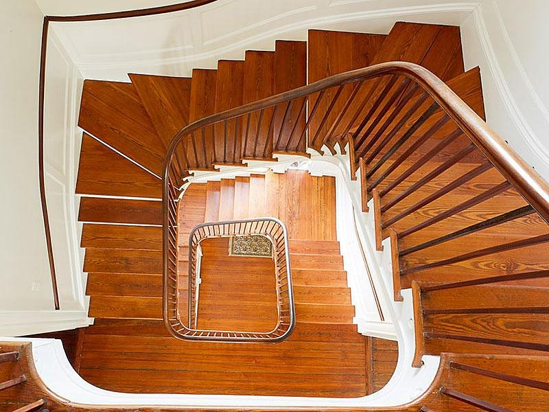 The floating wooden staircase makes for stunning traditional architecture. Source: Sotheby's