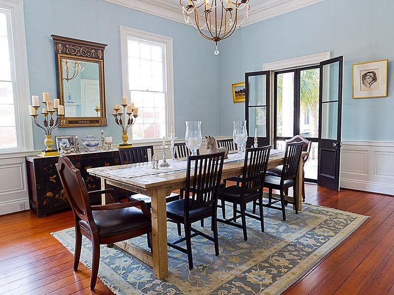 When Noah cooks dinner for Allie after years of being apart, they sit at opposite ends of a similar dining table. Mismatched chairs and a rustic table keep this modern version from feeling stuffy. Source: Sotheby's
