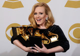Adele smiled and held onto all her awards in the 2012 Grammys press room.