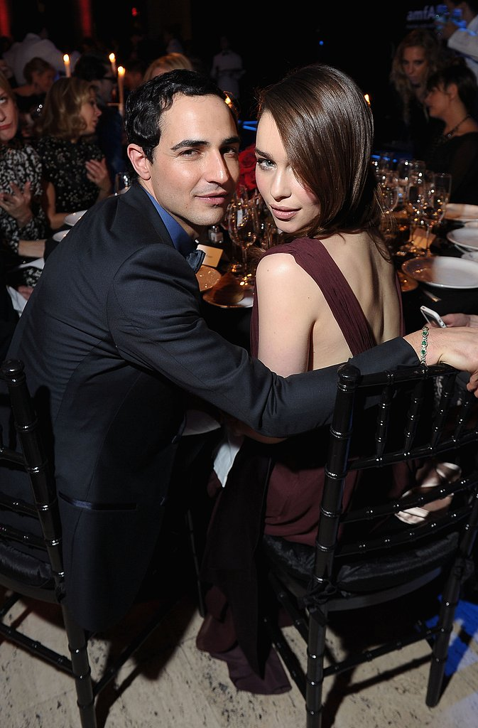 Emilia Clarke got cozy with Zac Posen inside the amfAR Gala on Wednesday night.