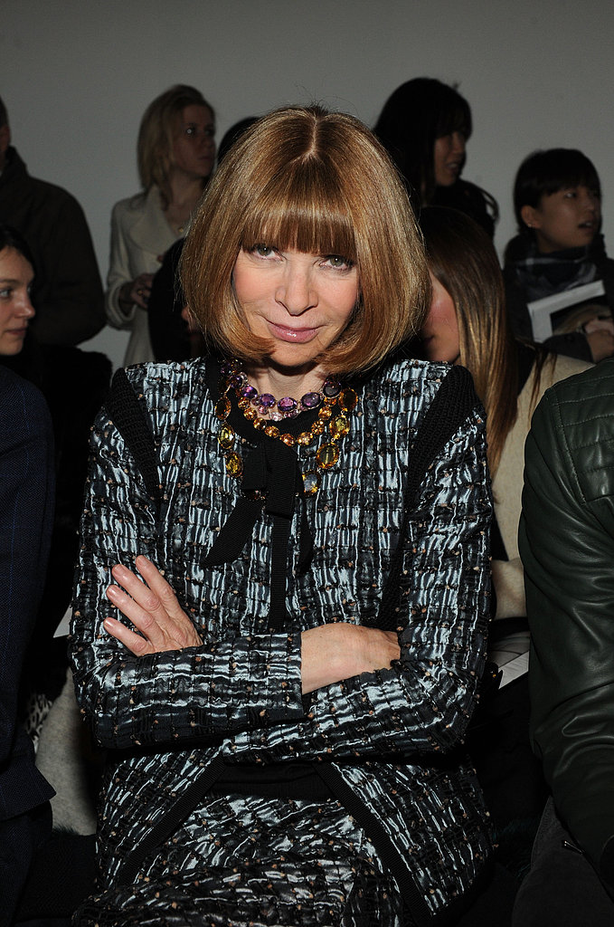 Donning a polished printed suit and a bevy of colourful necklaces, Anna Wintour was ready to critique the Creatures of the Wind collection.