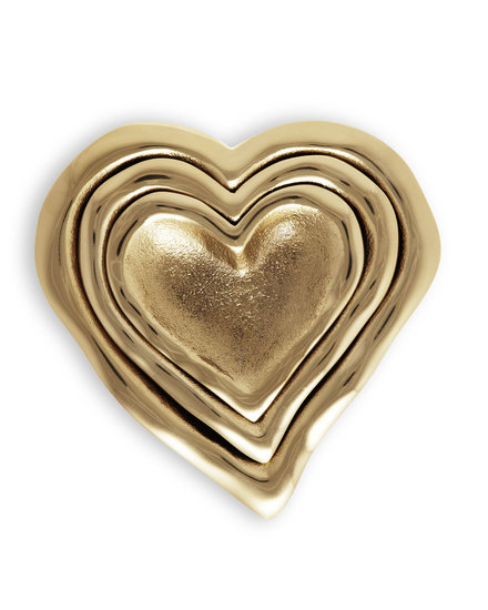 Give your glamorous girlfriend these gold heart nesting dishes ($240) for a fun, stylish pick.