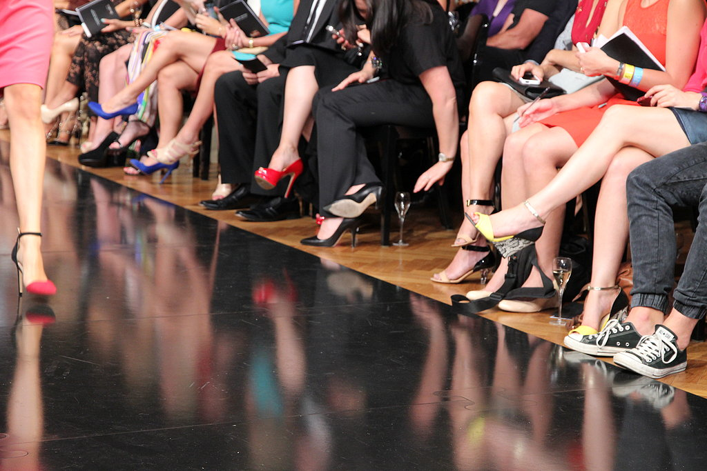 Half the fun of a fashion show is scooping (discreetly) what the front row is wearing.
