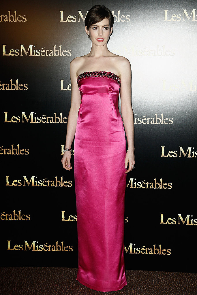 Anne Hathway ruled the red carpet in pink Prada at the Les Misérables premiere in Paris.