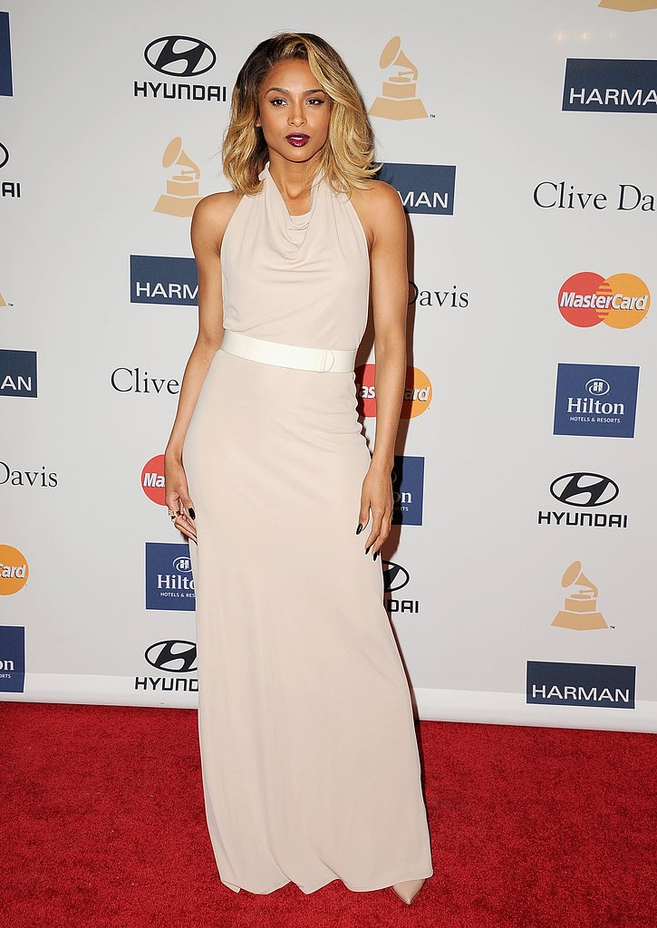 Ciara's nude halter gown hugged her curves in all the right places. We love the deep red lipstick, too.