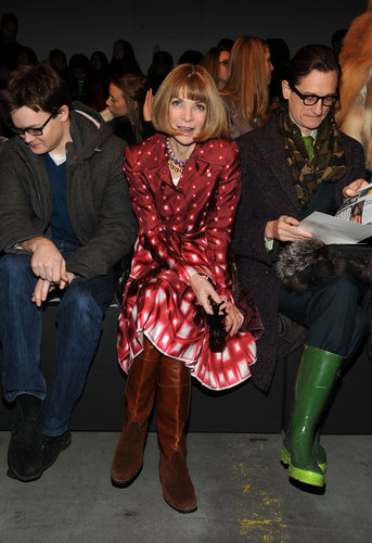 While taking in the Prabal Gurung show, Anna Wintour stood out among a sea of dark hues in her red-printed dress and brown knee-high boots.