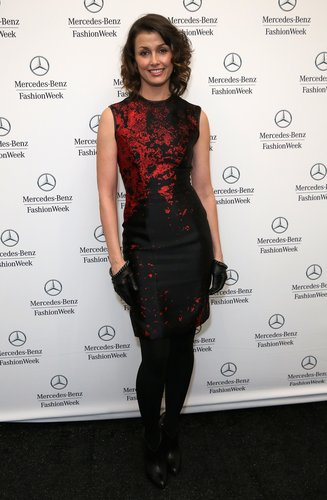Bridget Moynahan oozed dark glamour in a red-and-black sheath, studded leather gloves, and romantic curls at Monique Lhuillier.