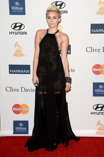 Miley Cyrus stunned in a black chiffon Emilio Pucci gown, complete with intricate embroidered detailing.