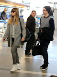 Justin Timberlake and Jessica Biel carried their bags through LAX.